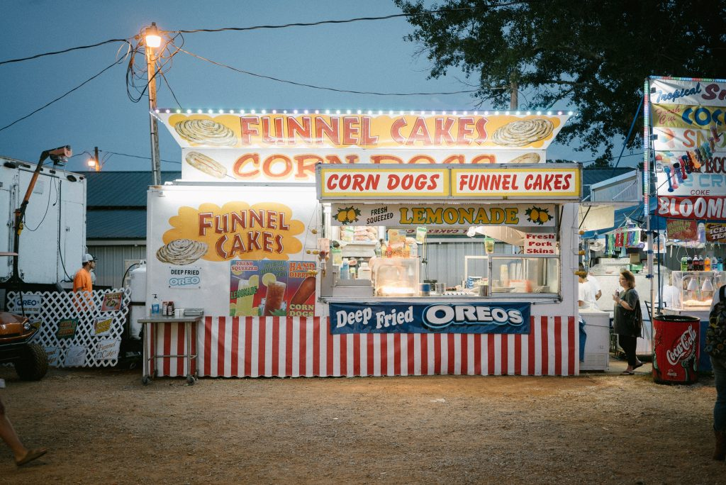 Photo by John Matychuk on Unsplash Funnel Cakes and Corn Dogs